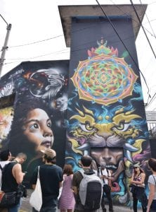 Urban-Art-Safari-Mural-by-Maskien-from-Costa-Rica,-Sinless-from-Panama-and-Humones-and-Frase-from-México.-Photo-by-María-Charles